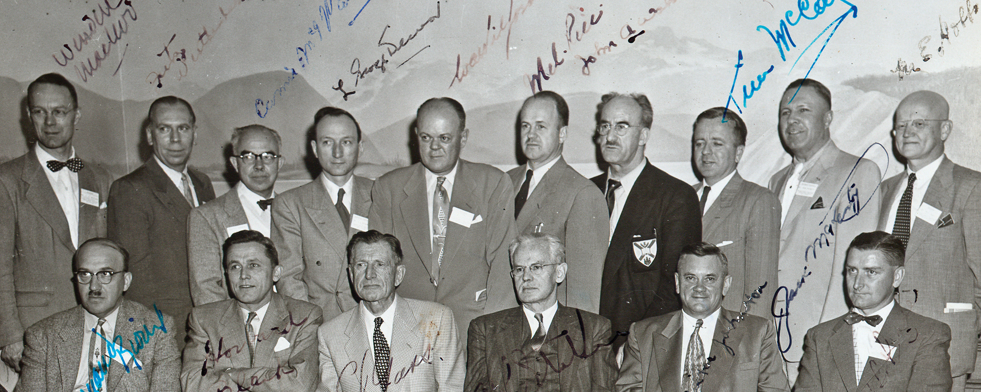 Black and white group image of a group of attendees from the CFPC's first inaugural meeting